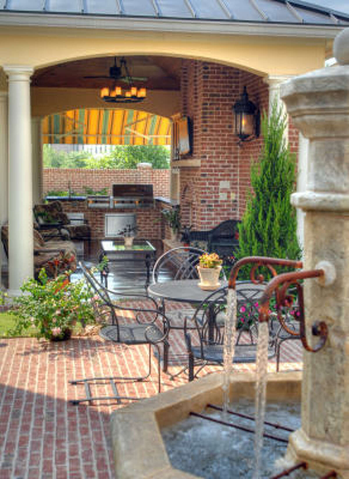 Outdoor kitchens can complement outstanding backyard landscaping and water features to create an elegant oasis.