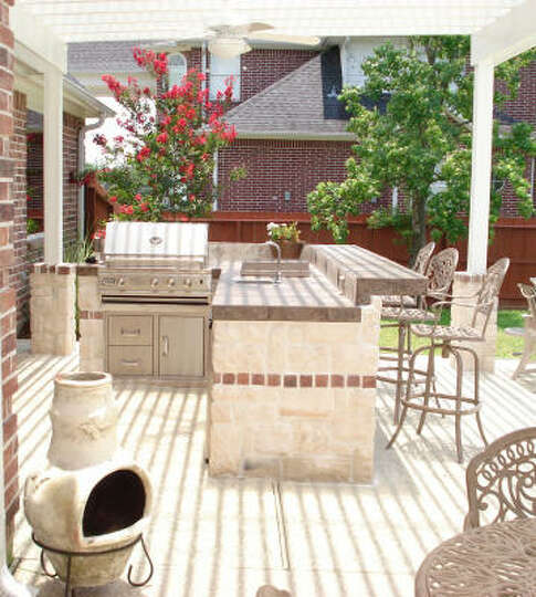 Brick Outdoor Kitchen: This Custom Outdoor Kitchen And Arbor Offer Stone And