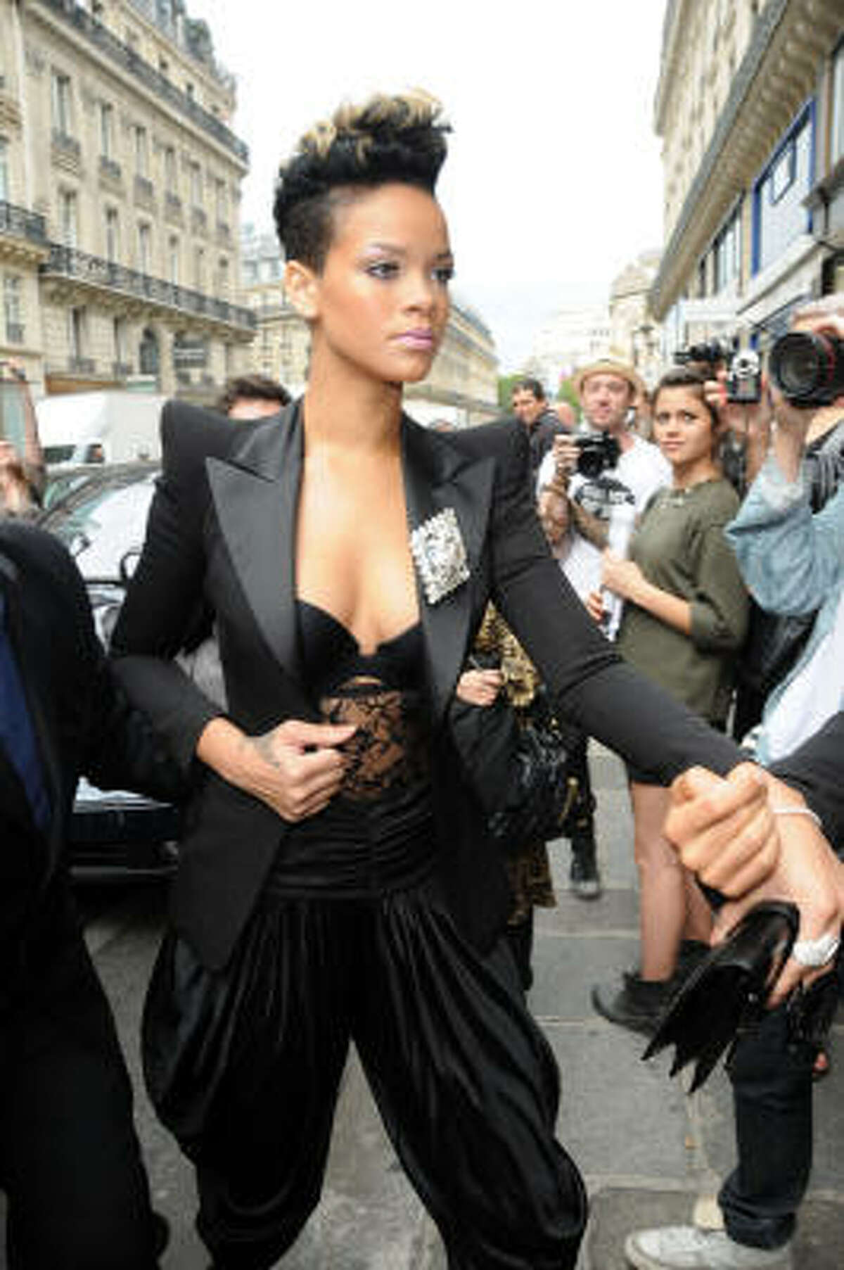 Rihanna at Paris Fashion Week dressed in the look for fall: shoulder pads. Don't worry ladies of the 80s, they're back. Read more about the style here.