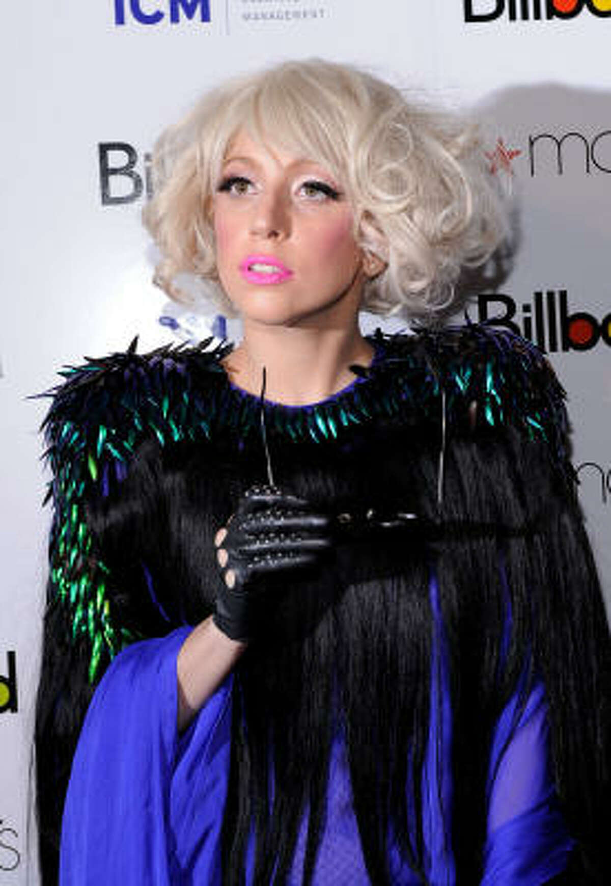Lady Gaga takes it back with feathers and accentuated shoulders.