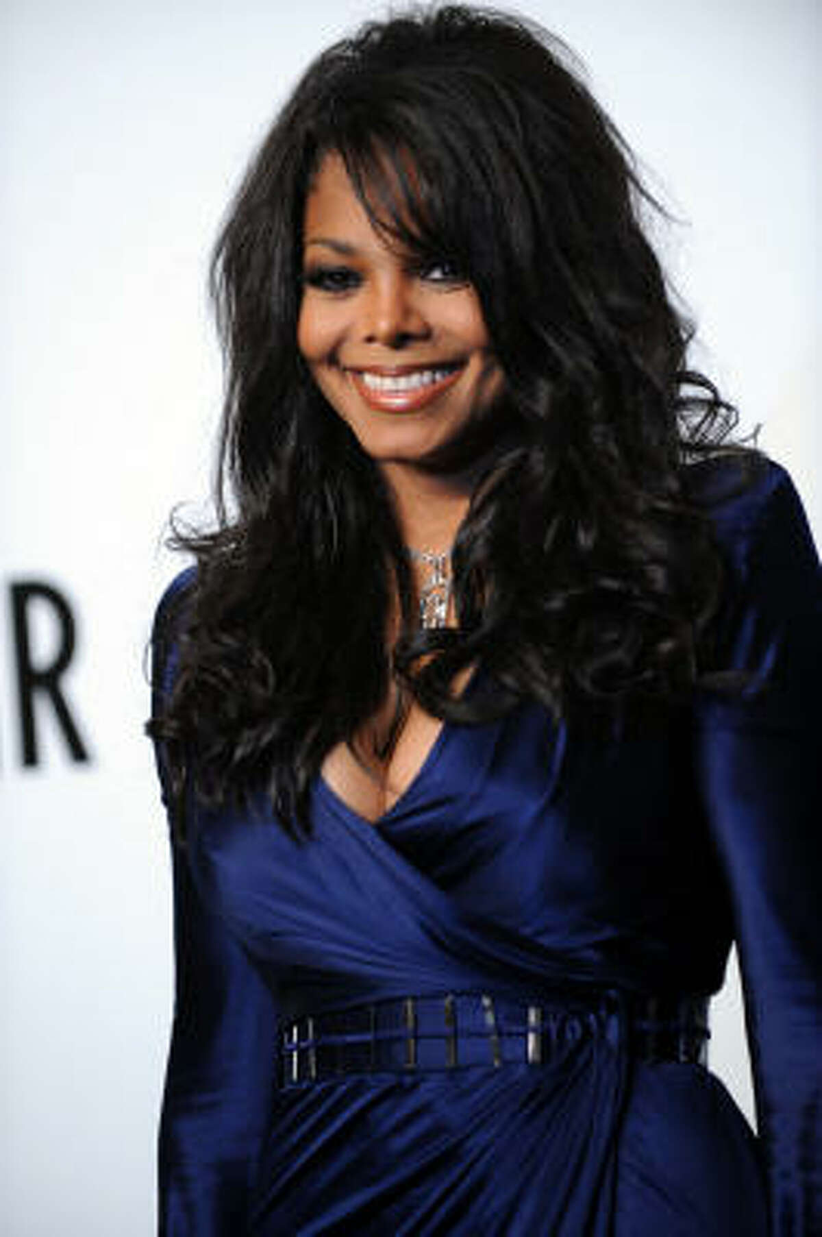 Janet Jackson subtly wears the retro look.
