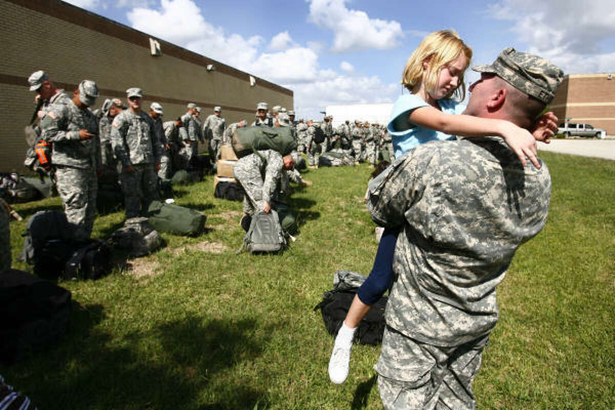 Sfc. Kevin Ethier carries daughter Hailey Ethier, 6, as the Delta Company 3rd of the 141st gets ready to leave the armory in Houston, TX. The troops will train as a brigade in Fort Bliss in preparation for their 9 month deployment to Iraq.