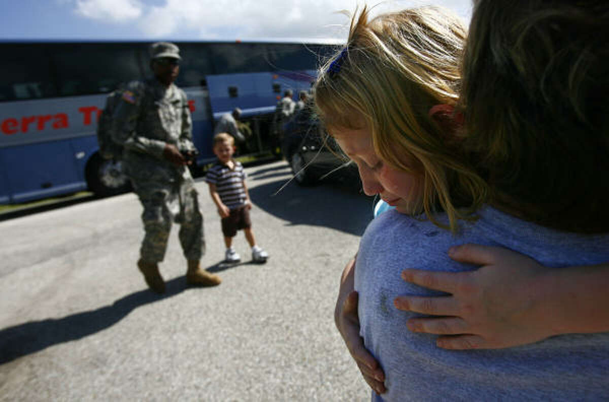 Hailey Ethier, 6, cries in her mother's arms after she said good-bye to father Sfc. Kevin Ethier.