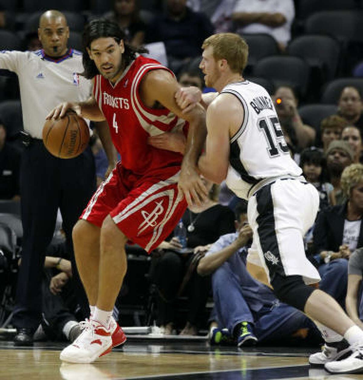Luis Scola, left, shot 5-for-9 from the field and scored 13 points.