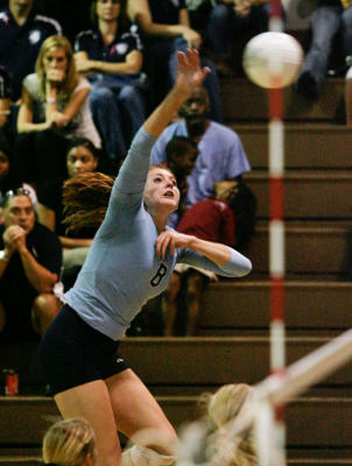 Kingwood outside hitter Danielle Espejo spikes the ball as part of the Mustangs' powerful attack.