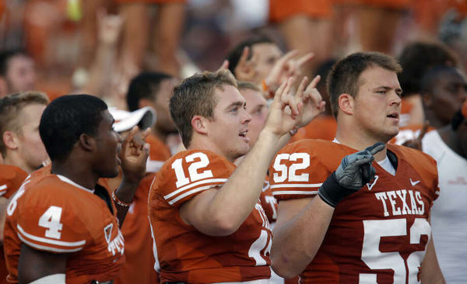 Texas LonghornsWhat we thought then: With the most accurate single-season quarterback in history and one of the deepest teams in the country, UT had all the makings of a national title contender.What we know now: A soft early schedule has proven little other than the Longhorns can survive, but with the way others are destructing, that's more than enough. Colt McCoy is as good as expected, and the defensive line is better than anyone thought.What we'll find out: Will the lack of a featured tailback hurt? If it doesn't by the end of a three week Oklahoma-Missouri-Oklahoma State stretch to end this month, UT fans might as well start booking tickets to Pasadena, Calif. Photo: Kin Man Hui, San Antonio Express-News