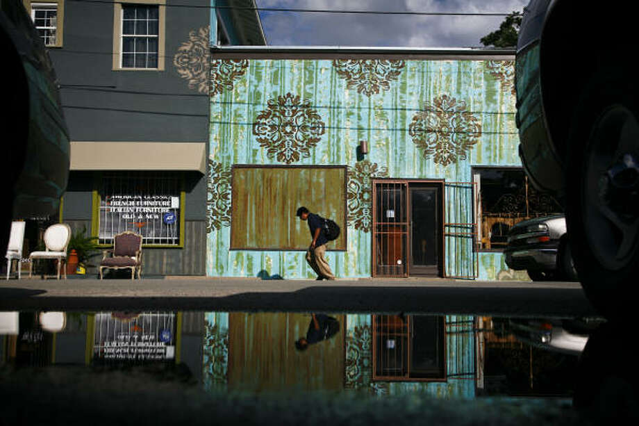 A boy walks near an antique store on the corner of Taft and Fairview in the Montrose area in Houston.  The American Planning Association has designated Montrose as one of America's 10 great neighborhoods. Photo: Michael Paulsen, Chronicle
