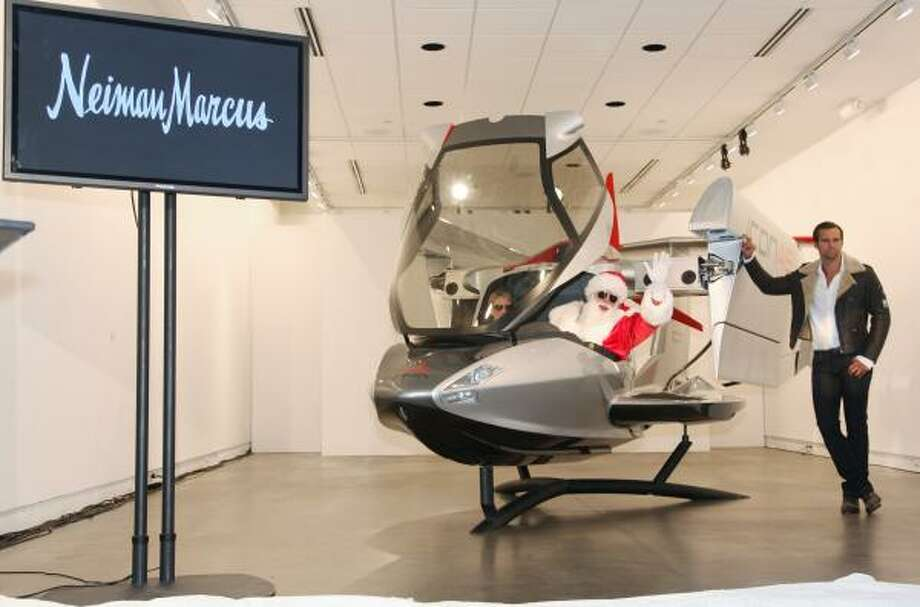 Neiman Marcus' 2009 Christmas Book was unveiled.It included gifts such as the new ICON A5 sports aircraft. A his and her gift that costs $250K and includes pilot training. To read about other gifts, click here. Photo: Tim Sharp, AP
