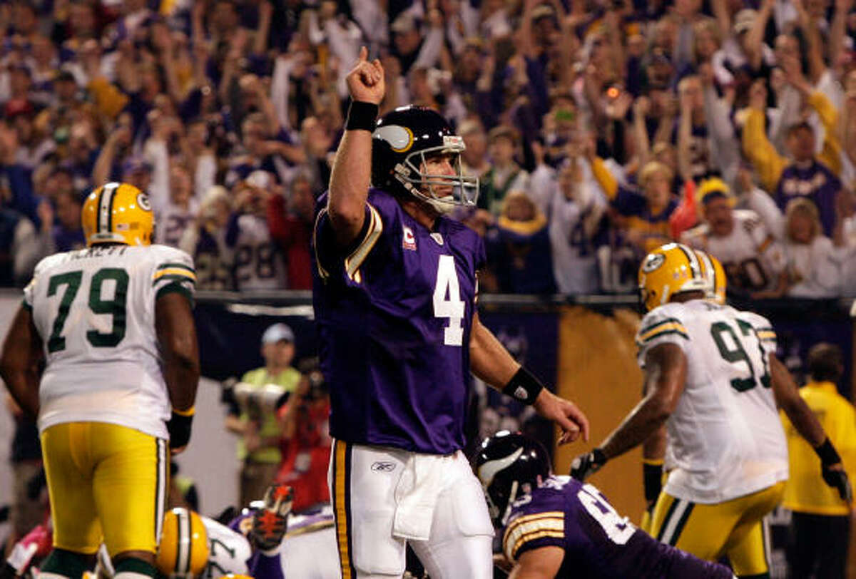 Vikings quarterback Brett Favre (4) celebrates after throwing a touchdown during Monday's game against the Packers at the Metrodome in Minneapolis. Favre threw for three touchdowns to lead the Vikings to a 30-23 win.