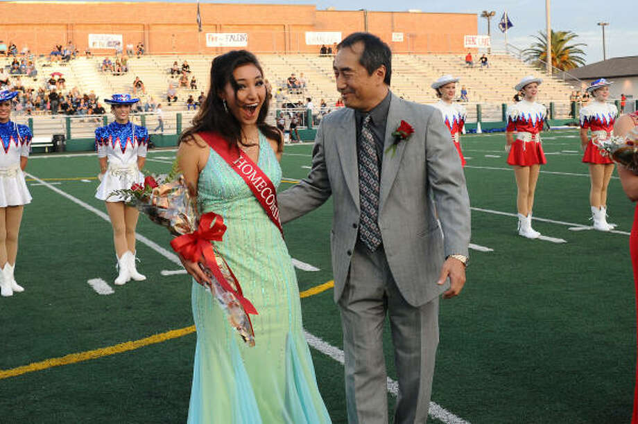 Clear Lake High School's Mika Tabata hears her name announced as 2009 homecoming queen. Photo: Kirk Sides, For The Chronicle