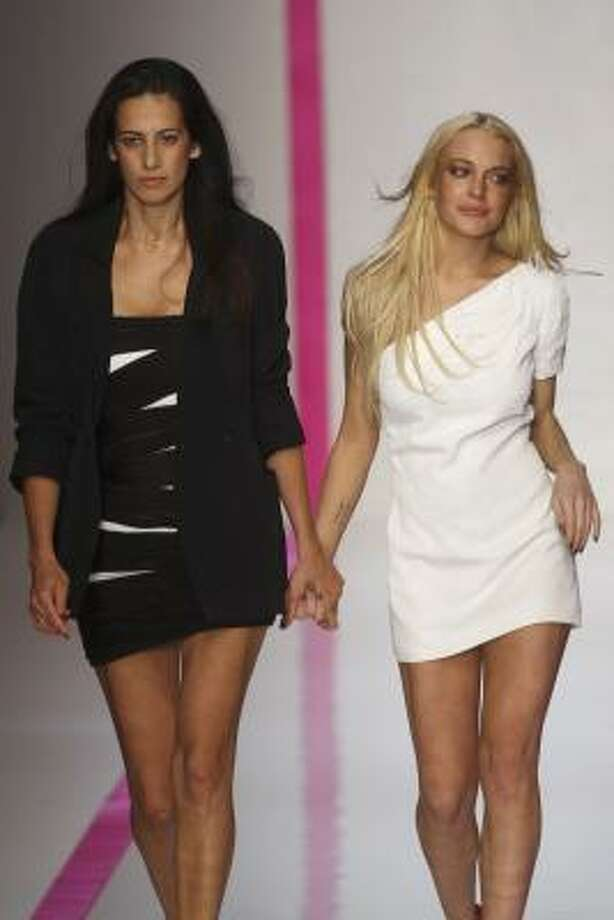 Estrella Archs walks with an emotional Lindsay Lohan for the French fashion house Emanuel Ungaro at Paris Fashion Week. Lohan recently took a job as fashion advisor for Ungaro. Photo: MICHEL EULER, AP