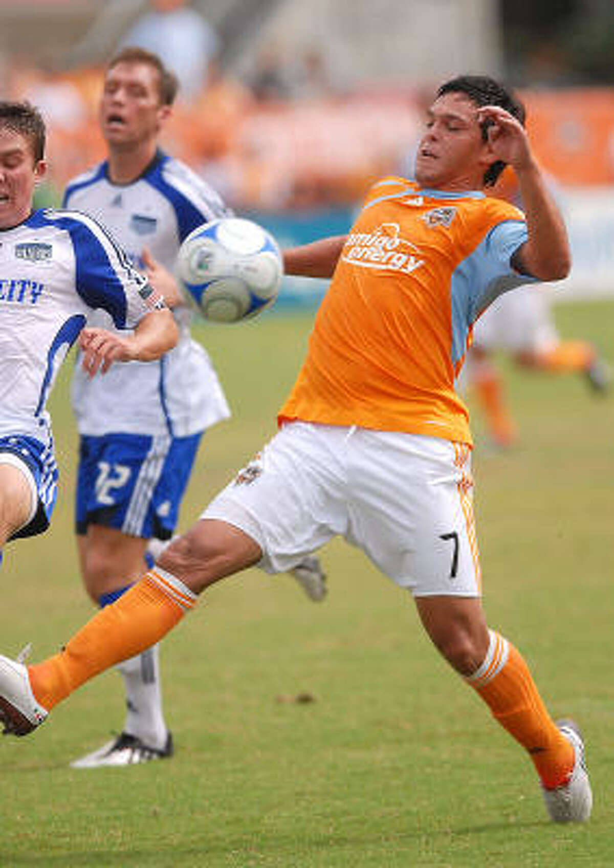 Dynamo forward Luis Angel Landin (right) scored a goal to help Houston capture a 1-1 tie in Sunday's match against the Kansas City Wizards and clinch a berth in the MLS playoffs.