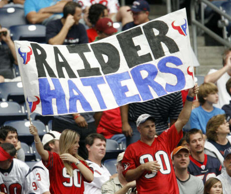 "Texans fans hold up a sign that reads ""Raider Haters"" during the fourth quarter. Photo: Karen Warren, Chronicle"