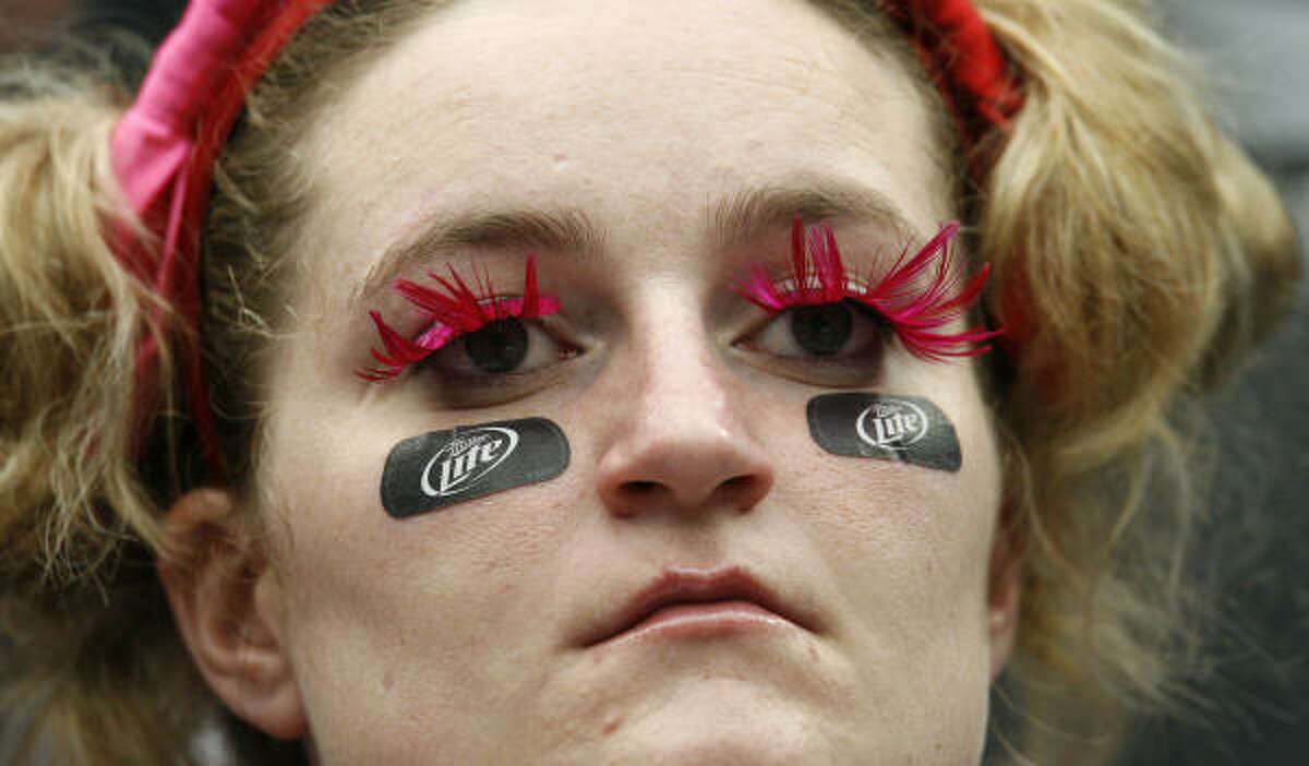 Amy Anderson wears her eye black and pink eyelashes in support of breast cancer awareness.