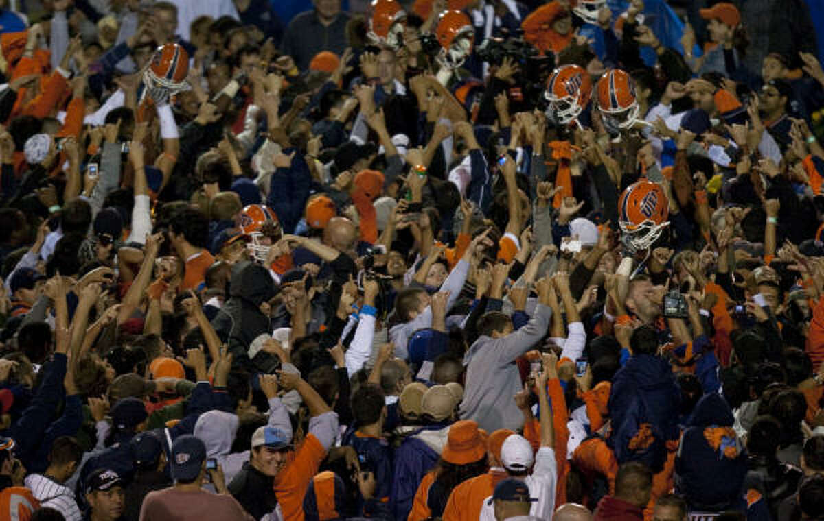 UTEP fans storm the field after the Miners' victory.