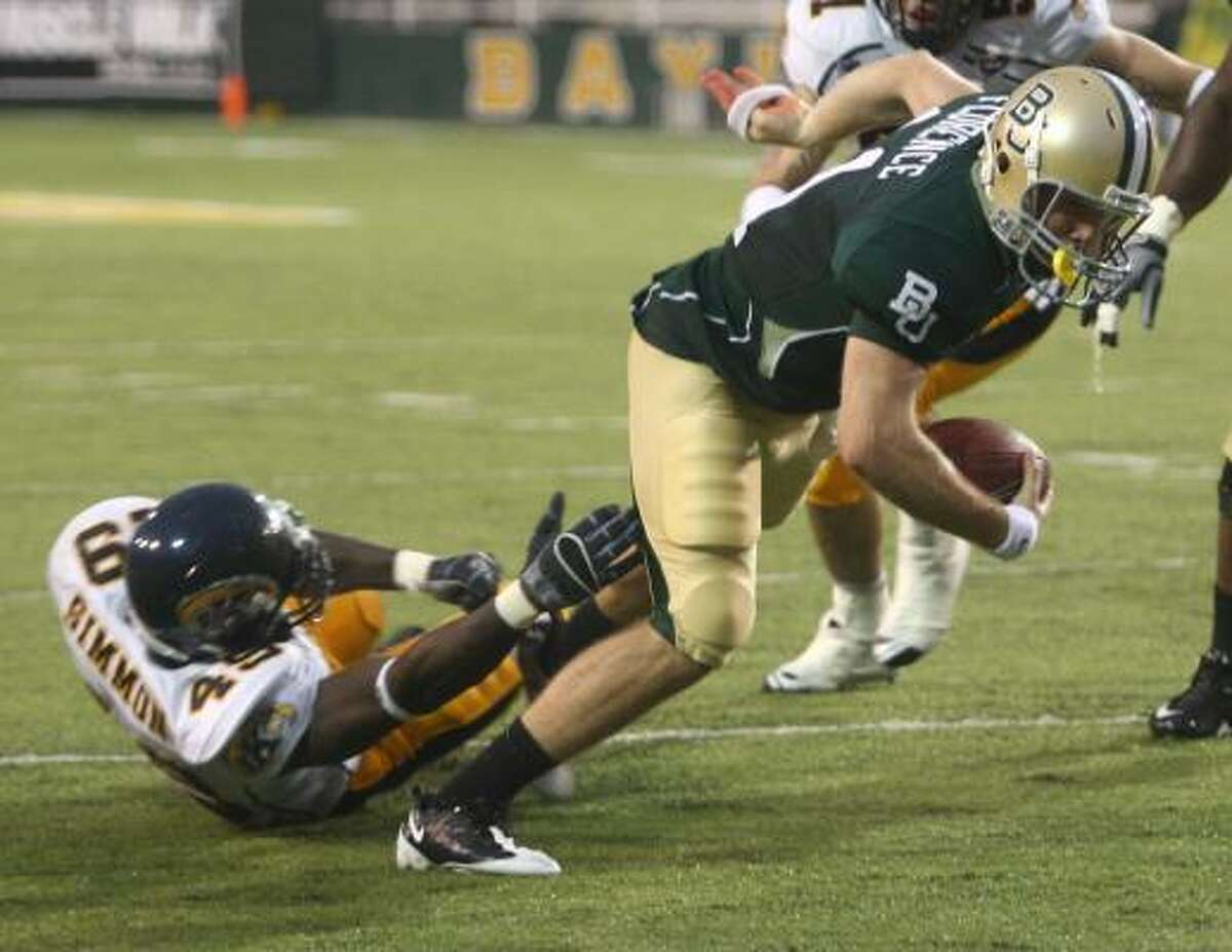Baylor quarterback Nick Florence, right, dives into the end zone for a second-quarter touchdown in front of Kent State's Monte Simmons (49) during their matchup on Saturday in Waco.