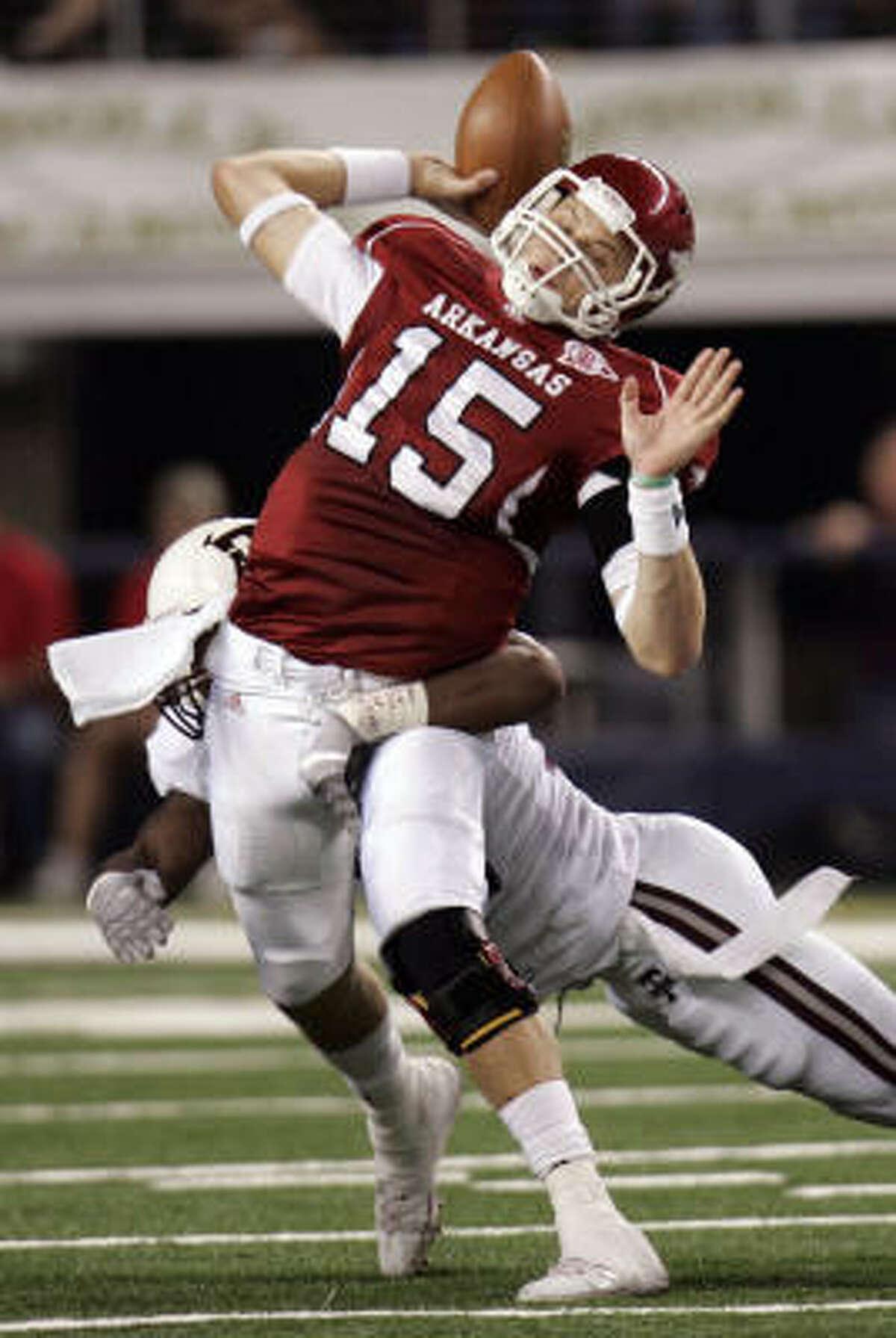 Arkansas' Ryan Mallett is hit by Texas A&M's Von Miller during the second quarter.
