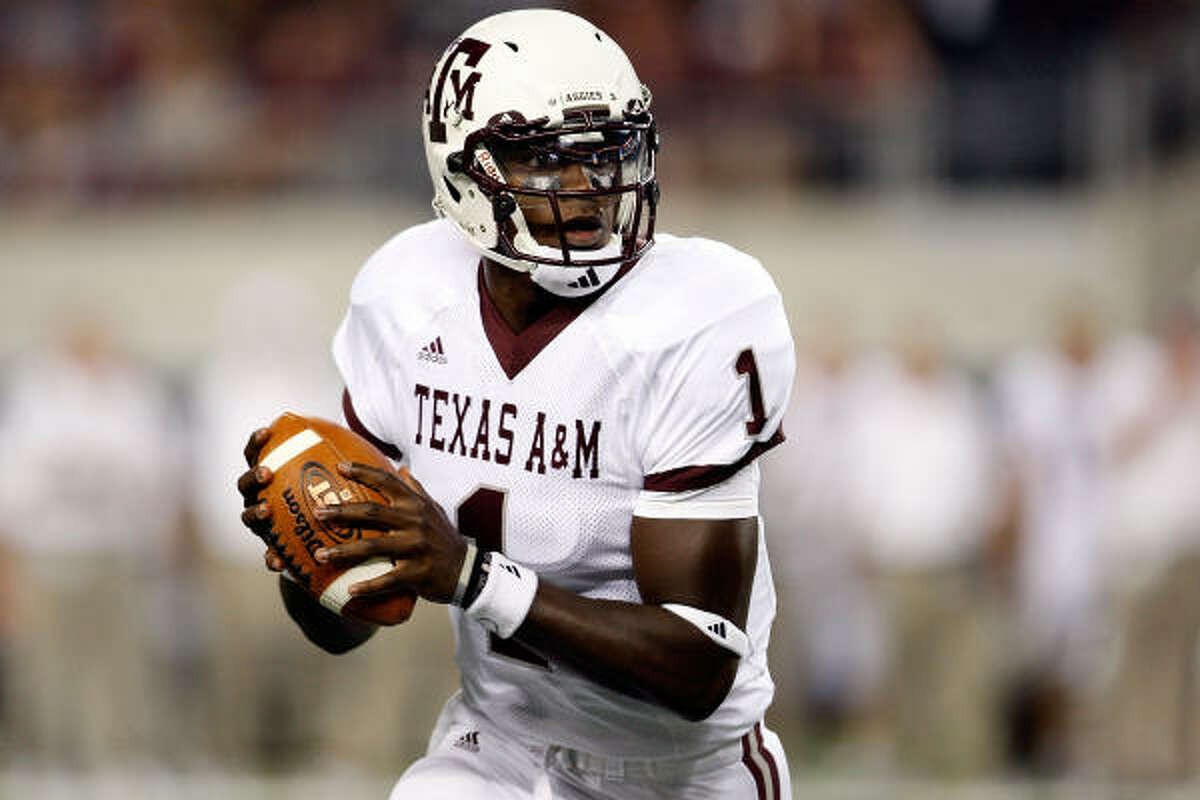 Texas A&M quarterback Jerrod Johnson drops back to pass against Arkansas Razorbacks during their game at Dallas Cowboys Stadium on Saturday.