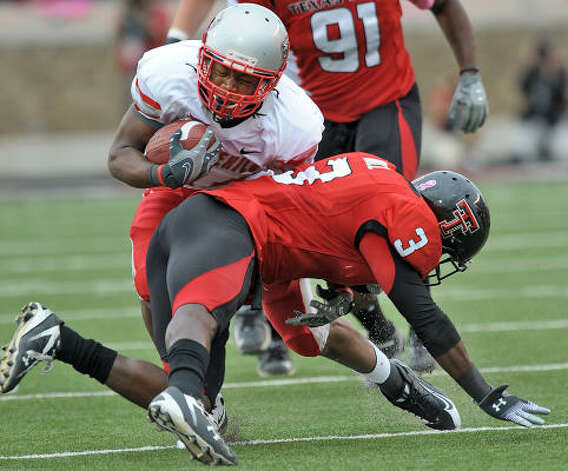 New Mexico's A.J. Butler, left, runs into Texas Tech defensive back Jamar Wall. Photo: John A. Bowersmith, AP