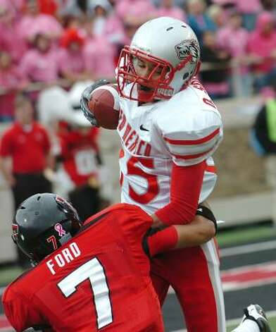 New Mexico's Quintell Solomon, top, gets hit by Texas Tech's Seth Will Ford. Photo: John A. Bowersmith, AP