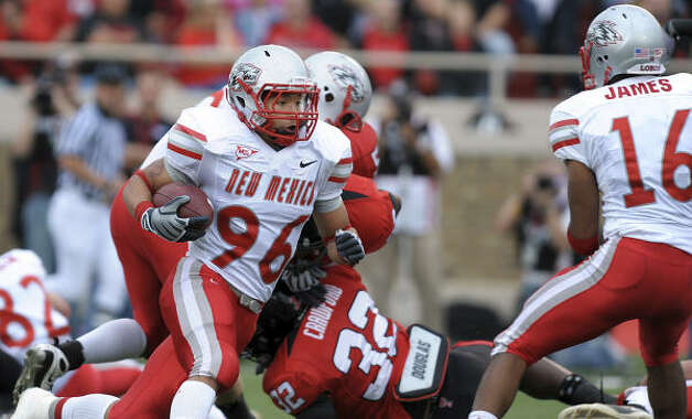 New Mexico's Frankie Solomon runs the ball against Texas Tech. Photo: John A. Bowersmith, AP