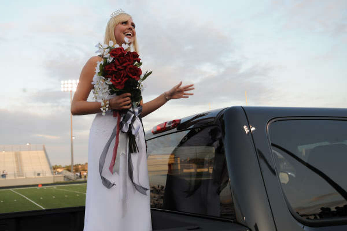 Katelyn Knight is paraded around the field after being named Pearland's Homecoming Queen during a pre-game ceremony at The Rig stadium.