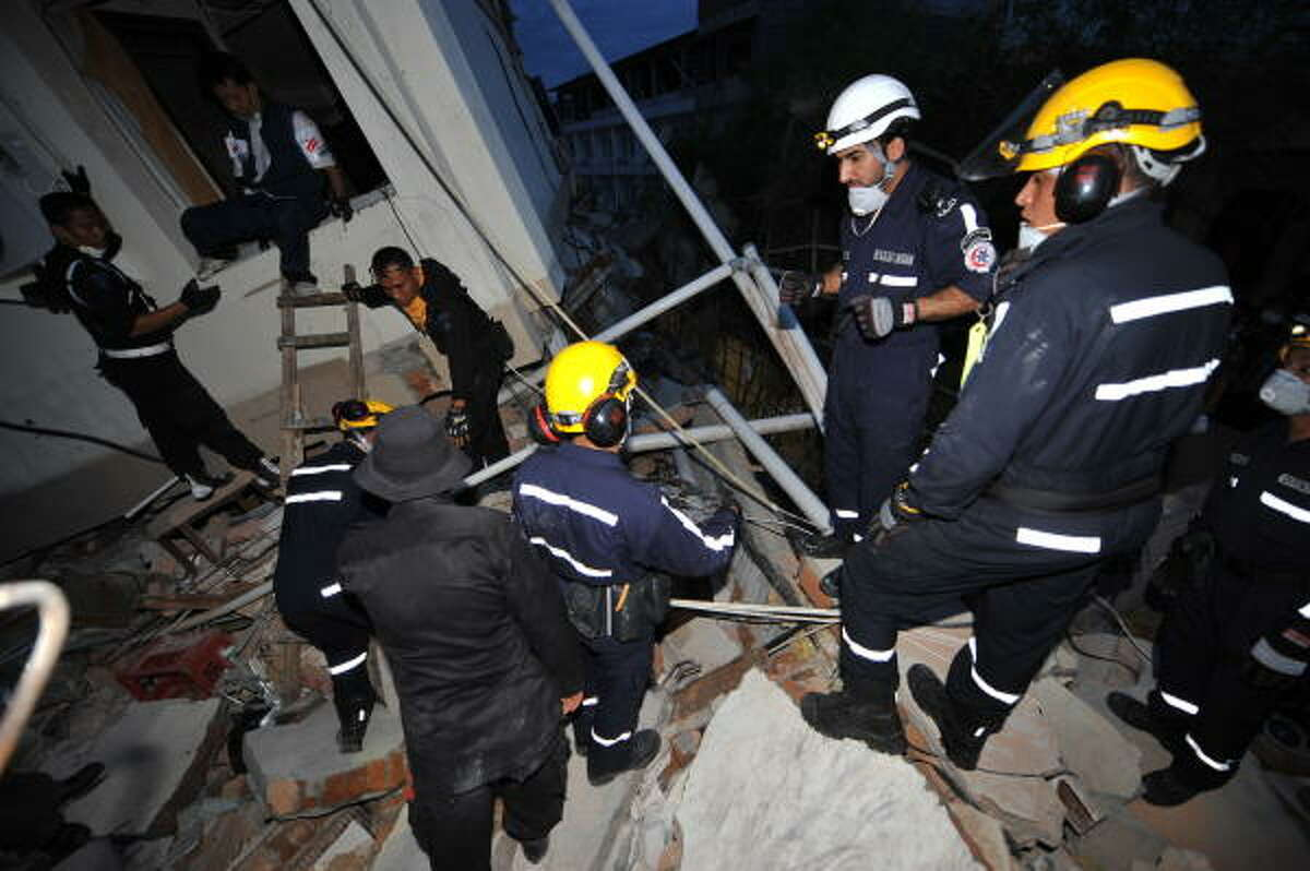 Rescuers from United Arab Emirates prepare to evacuate victims from a collapsed hotel building in the Sumatran city of Padang on Saturday.