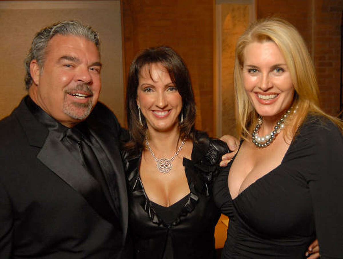 Frank DeLape, Alicia Smith and Kimberly DeLape at the Best Buddies benefit at the home of Becca Thrash, Wednesday, Sept. 30.