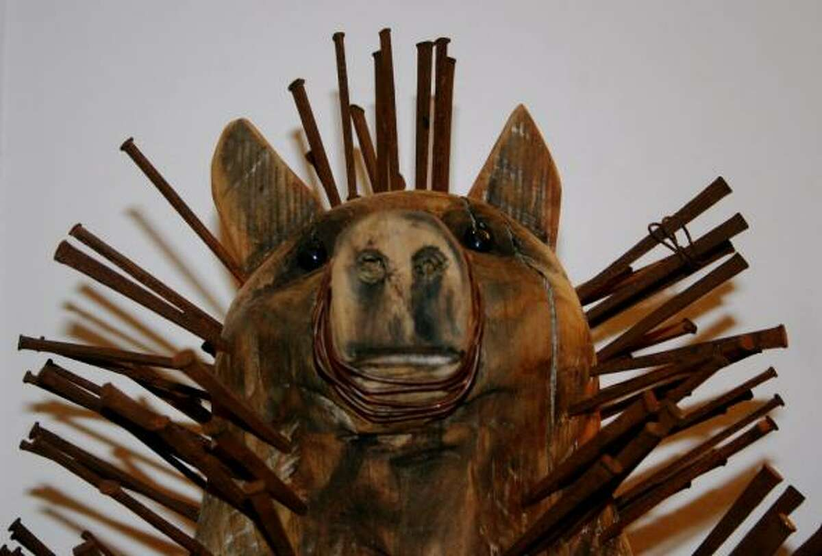 ''Flood Pig, Nzale Ngulu'' by Sue Ruthstrom is made from rusty nails collected after the storm.