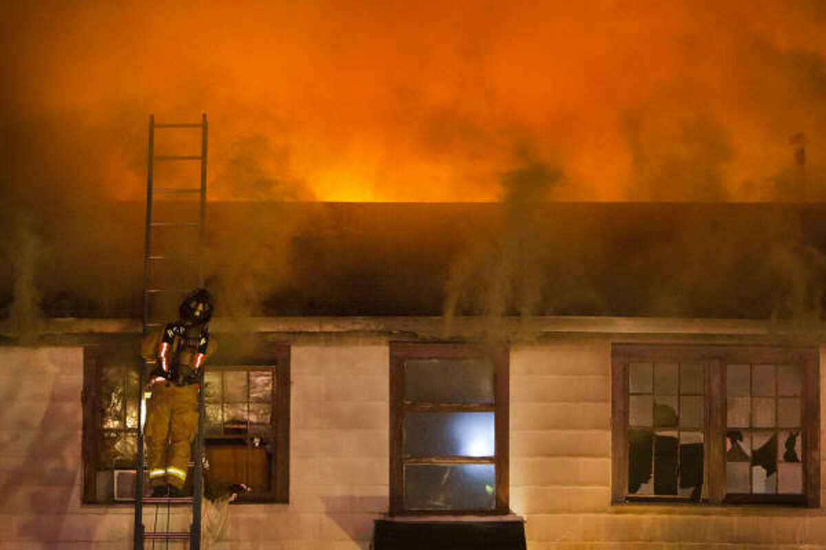 Houston firefighters respond to a fire at 1030 1/2 Ashland in the Heights in the early morning hours today. It's the latest in a string of fires that have hit the Heights, most on the same block of Ashland.