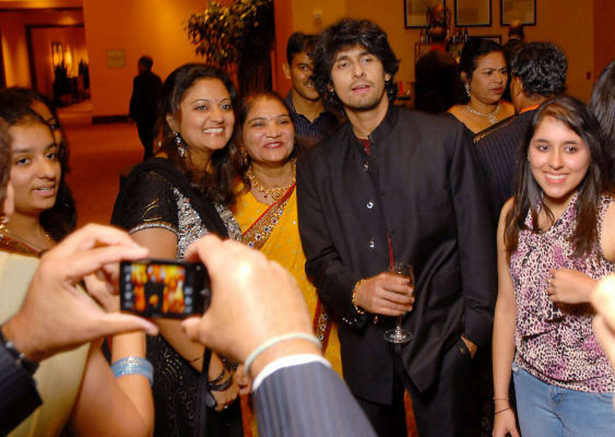 Fans surround singer Sonu Niigaam at the Indian Film Festival Celebrity Gala at the InterContinental Hotel Saturday evening Sept. 26.