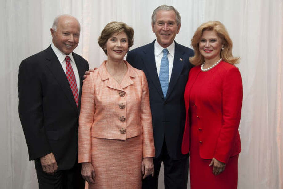 Dan Duncan (left) is again the wealthiest Houstonian and 30th-wealthiest American with a fortune estimated at $8 billion, according to Forbes. He is shown here earlier this year with former first lady Laura Bush, former President George W. Bush and Duncan's wife, Jan Duncan. See the richest Texans here. Photo: Baylor College Of Medicine