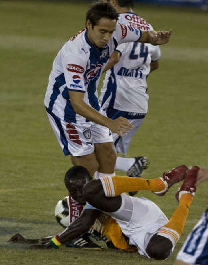 Dynamo's Dominic Oduro (bottom) collides with Pachuca's Carlos Rodriguez (top) during the first half. Photo: James Nielsen, Chronicle