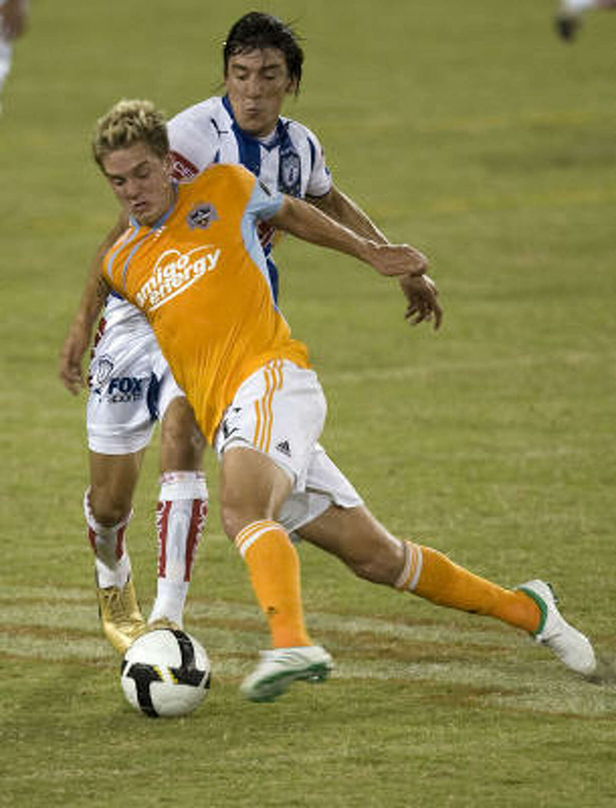 Dynamo's Stuart Holden (left) and Pachuca's Edgar Benitez (right) battle for the ball during the first half.