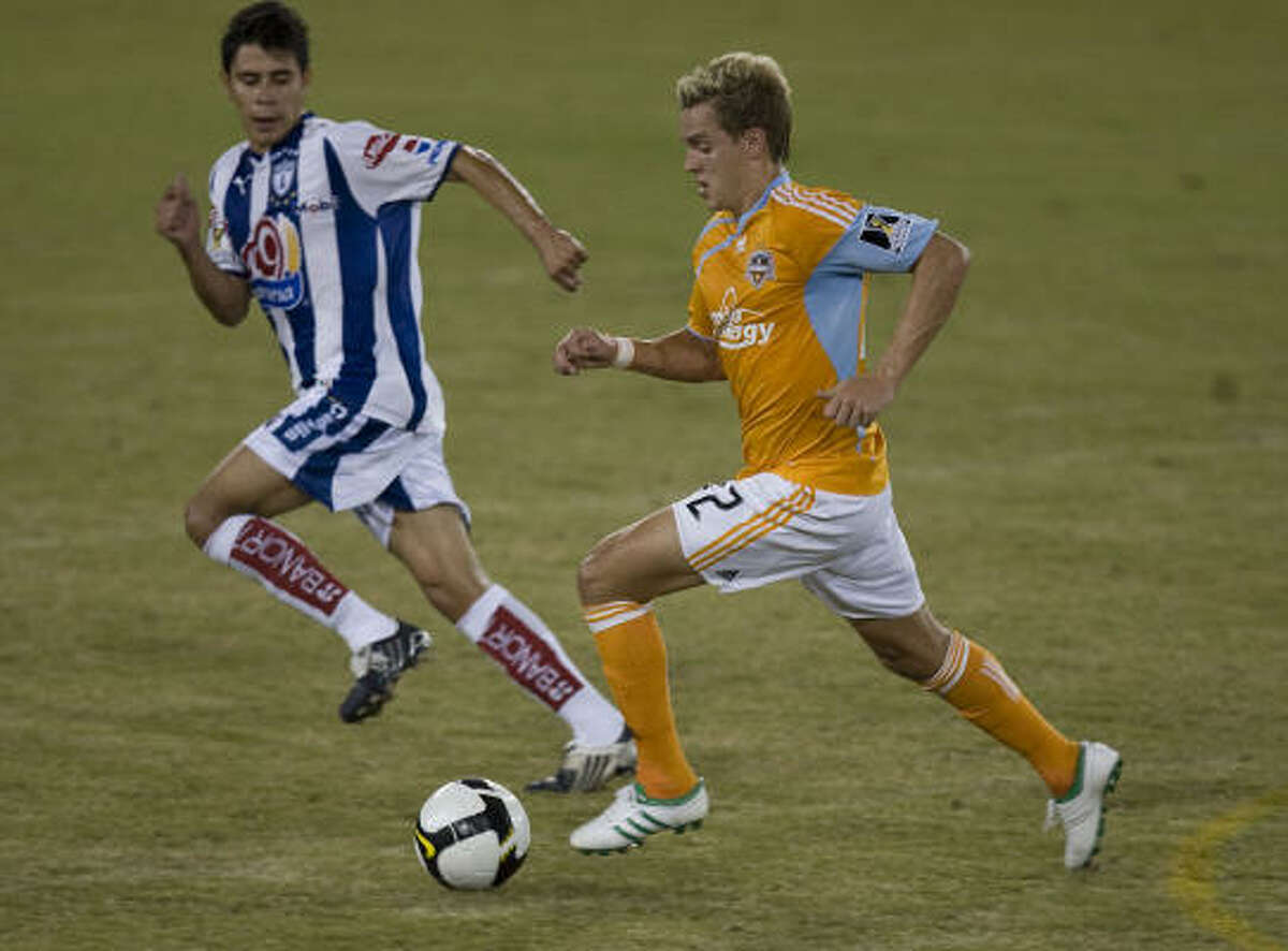 Dynamo's Stuart Holden (right) looks to pass Pachuca's Raul Martinez (left) during the first half.