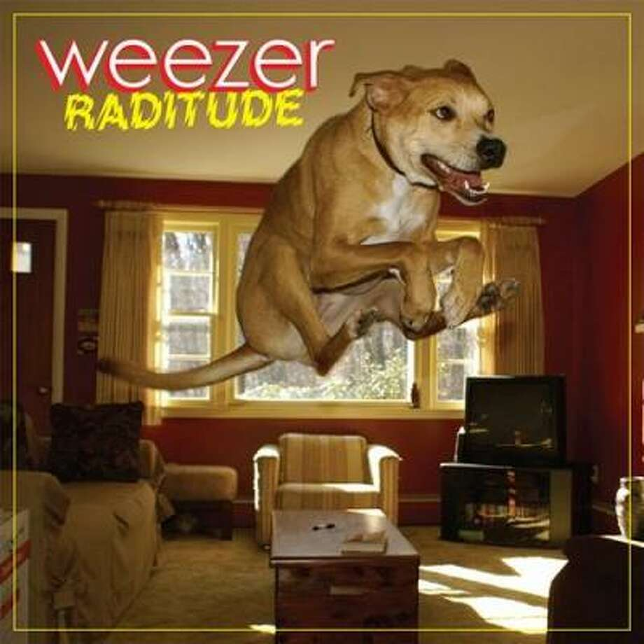 Weezer's album due in stores Oct. 27 features a photo of an amazing high-flying dog that a reader sent to National Geographic magazine. How does it rank with past album covers featuring dogs? Check out the following lineup. Is your favorite here?