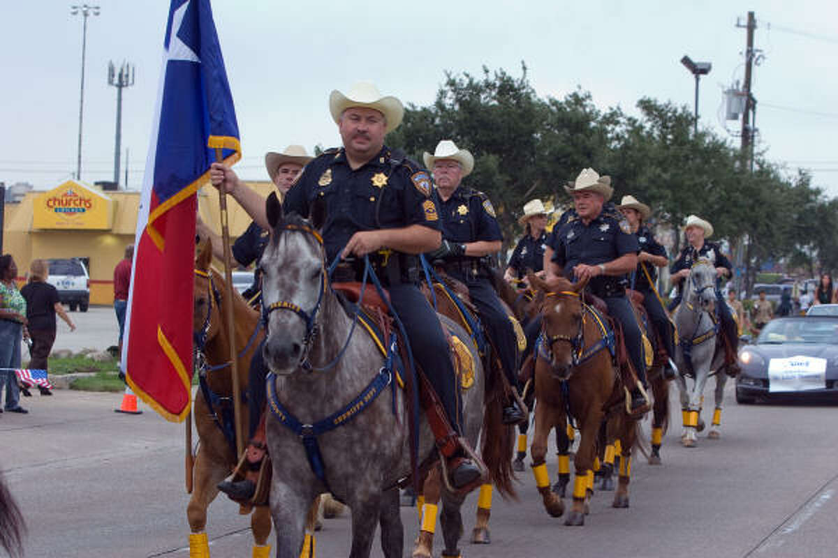 ALIEF INTERNATIONAL PARADE: A detachment from the Harris County Sheriff's Department mounted posse leads off the the Alief International Parade.