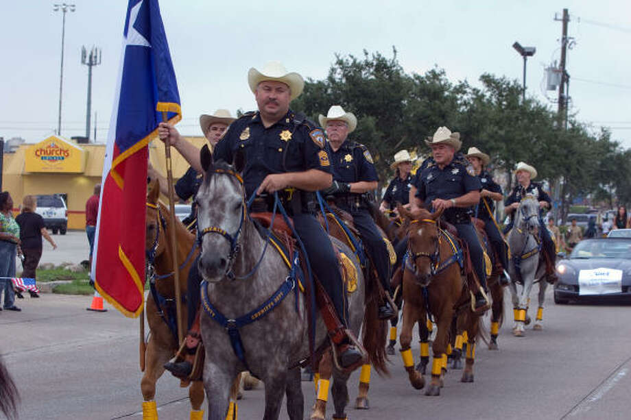 ALIEF INTERNATIONAL PARADE:A detachment from the Harris County Sheriff's Department mounted posse leads off the the Alief International Parade. Photo: R. Clayton McKee, For The Chronicle