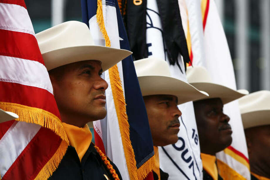 "Pedro Acosta (left to right), Deputy Darryl Peaks and Rufus Yarborough, Members of the Harris County Sheriff 's Office Honor Guard, stand ready outside the Co-Cathedral of the Sacred Heart during a special ""Blue Mass"" for Law Enforcement Officers of all of the municipalities of the Archdiocese of Galveston-Houston.  Civilian and sworn employees of criminal justice agencies, their families and supporters attend the 10:00am mass lead by Cardinal Daniel DiNardo Tuesday, Sept. 29, 2009, in Houston. Photo: Michael Paulsen, Chronicle"