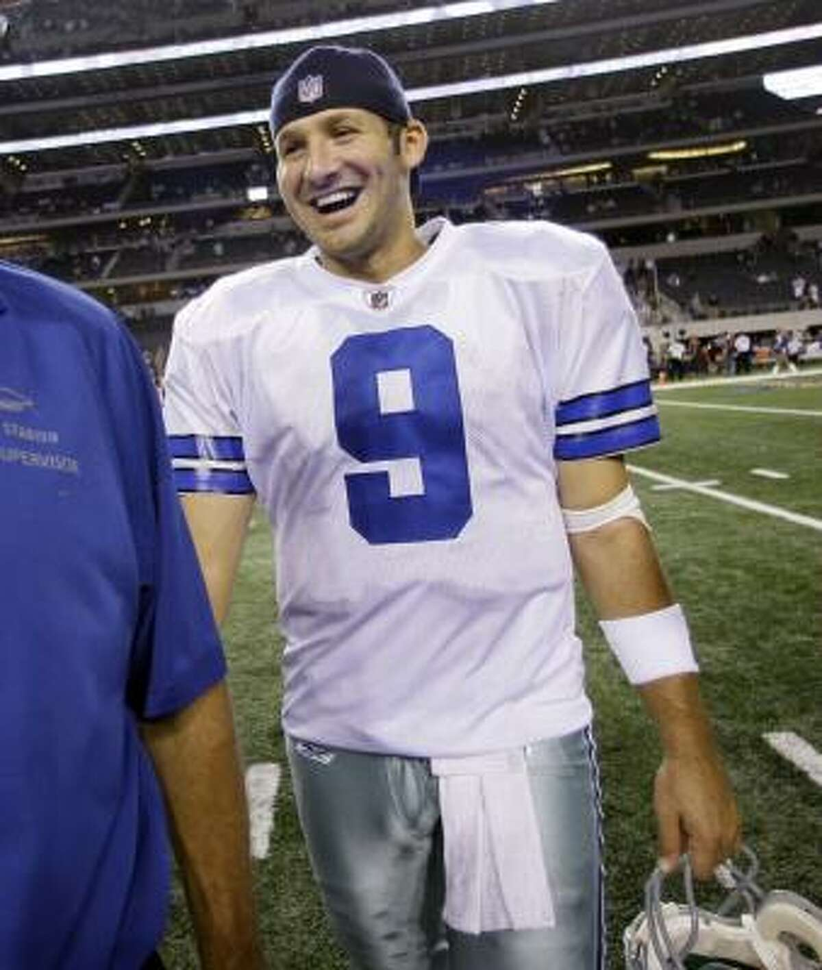 Cowboys 21, Panthers 7 Dallas Cowboys quarterback Tony Romo smiles as he walks off the field at the end of the game after defeating the Panthers 21-7.