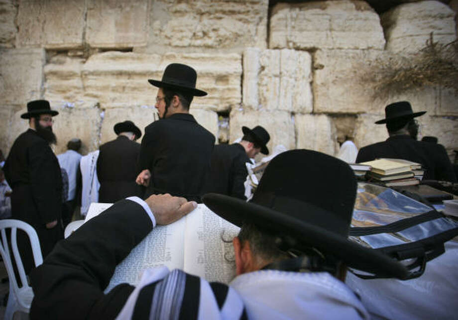 Ultra-Orthodox Jewish men pray at the Western Wall, Judaism's holiest site, in Jerusalem's Old City on Sunday, Sept. 27, 2009. Yom Kippur began at sundown Sunday and ends on Monday at sundown. The holy day is observed with a 25-hour period of fasting and prayer. Photo: DAN BALILTY, AP