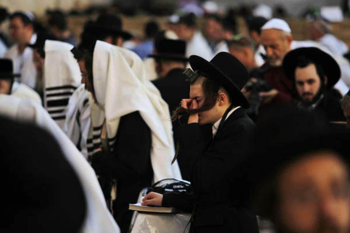 Ultra-Orthodox Jewish men pray at the Western Wall, Judaism's holiest site, in Jerusalem's Old City on Sunday, Sept. 27, 2009.