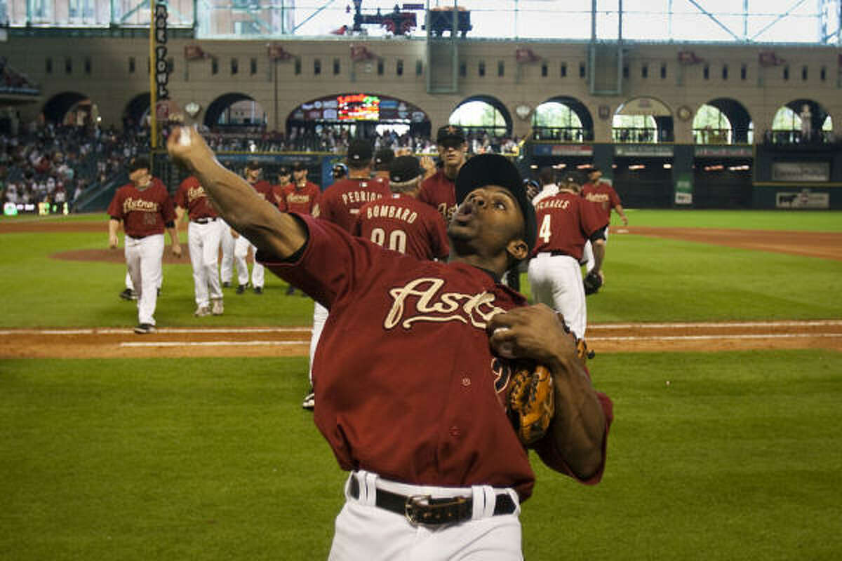 Sept. 27: Astros 3, Reds 2 Astros center fielder Michael Bourn tosses souvenir baseballs to the crowd after Sunday's game.