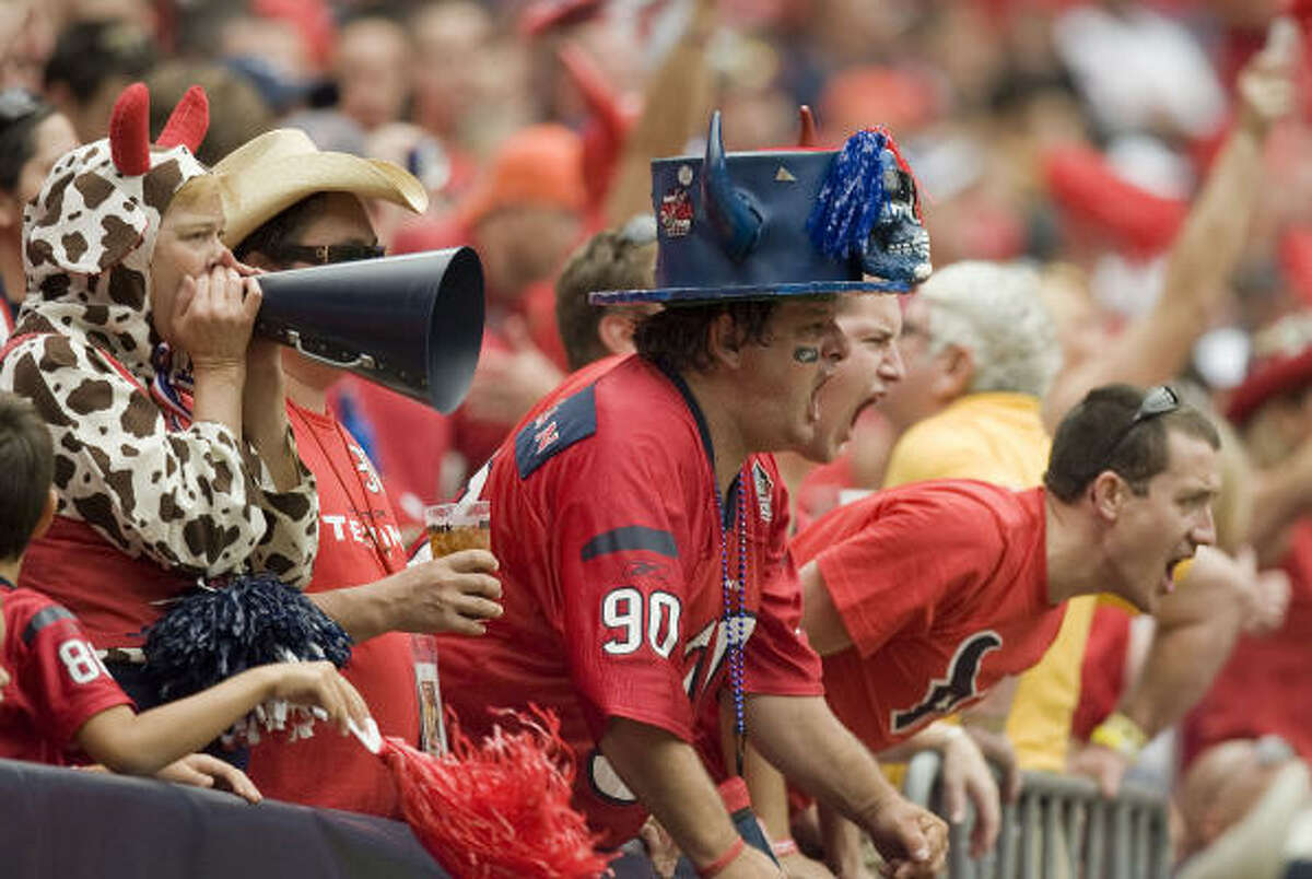 Texans fans yell during the first half of the game against the Jacksonville Jaguars.