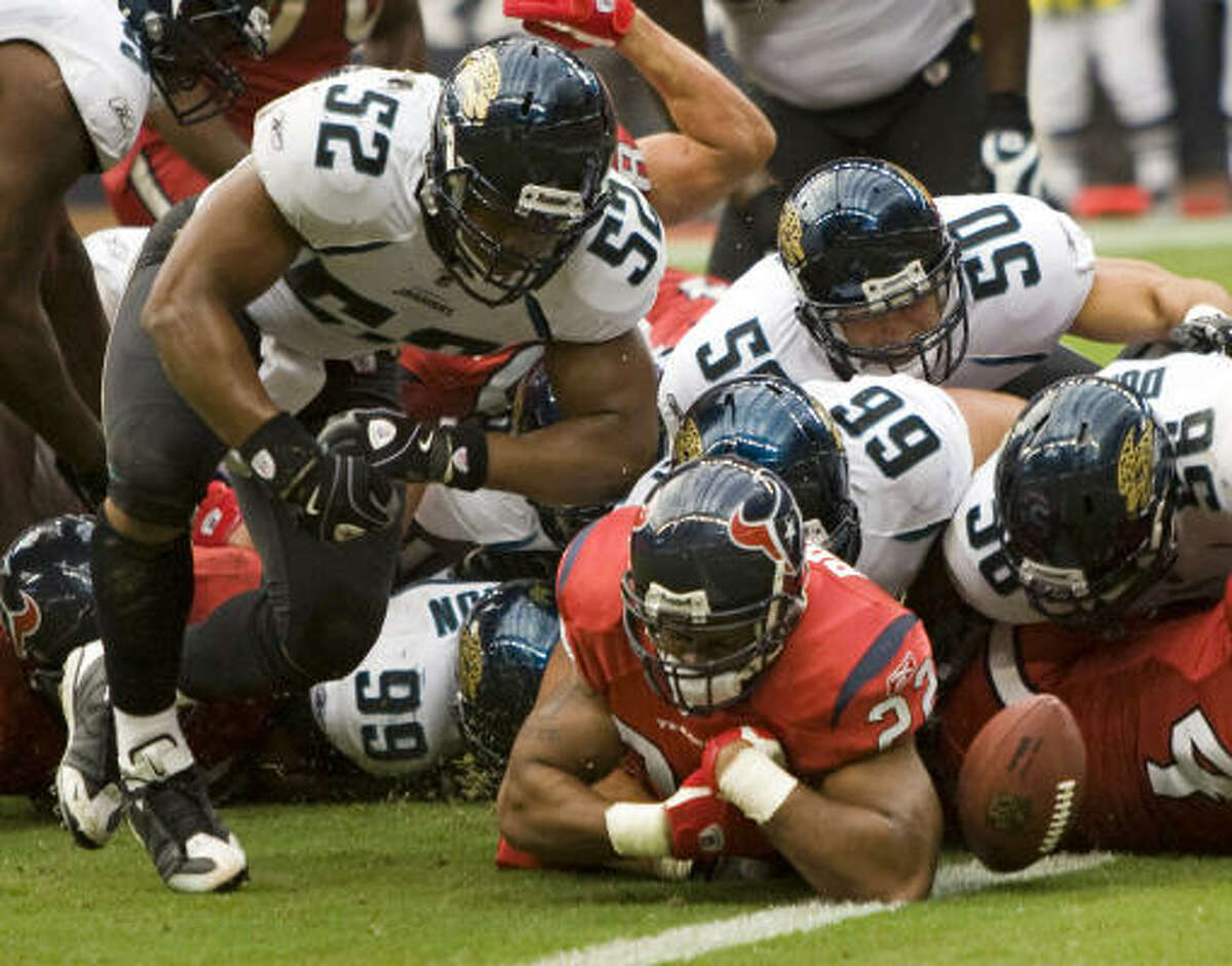 Texans running back Chris Brown fumbles near the goal line late in the fourth quarter against Jacksonville. The Jaguars recovered in the end zone to seal the 31-24 victory over the Texans.