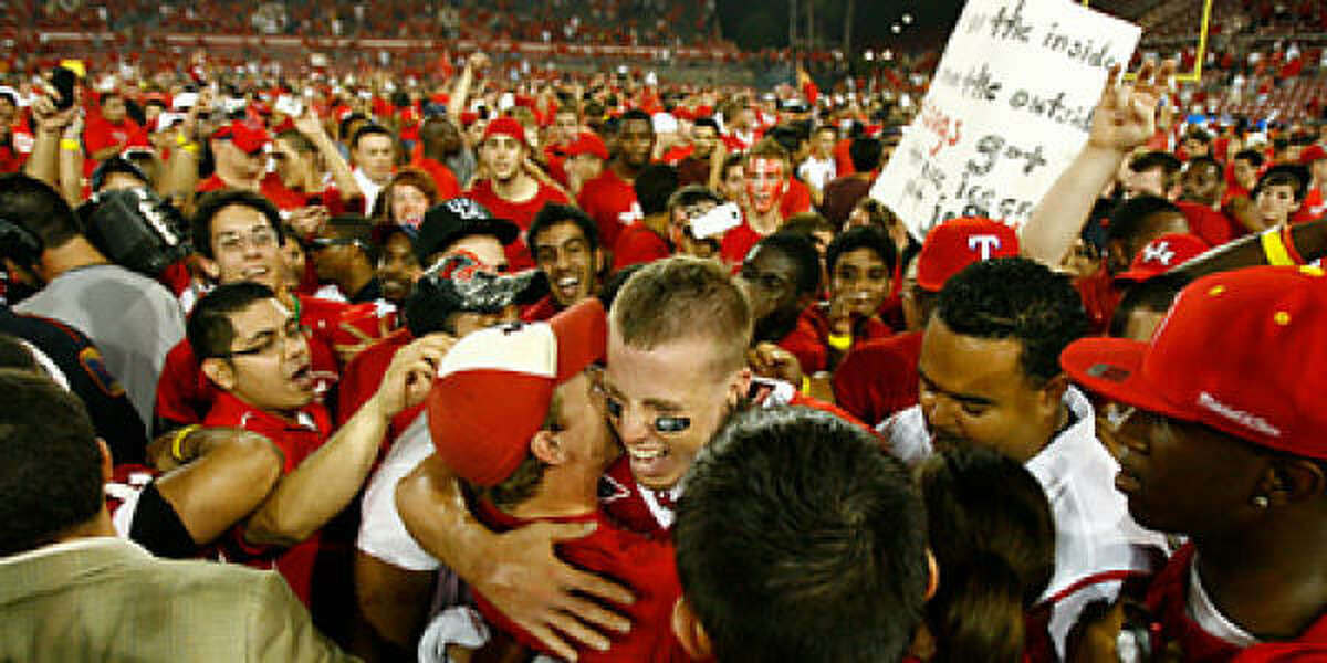 The crowd celebrates with QB Case Keenum, center.