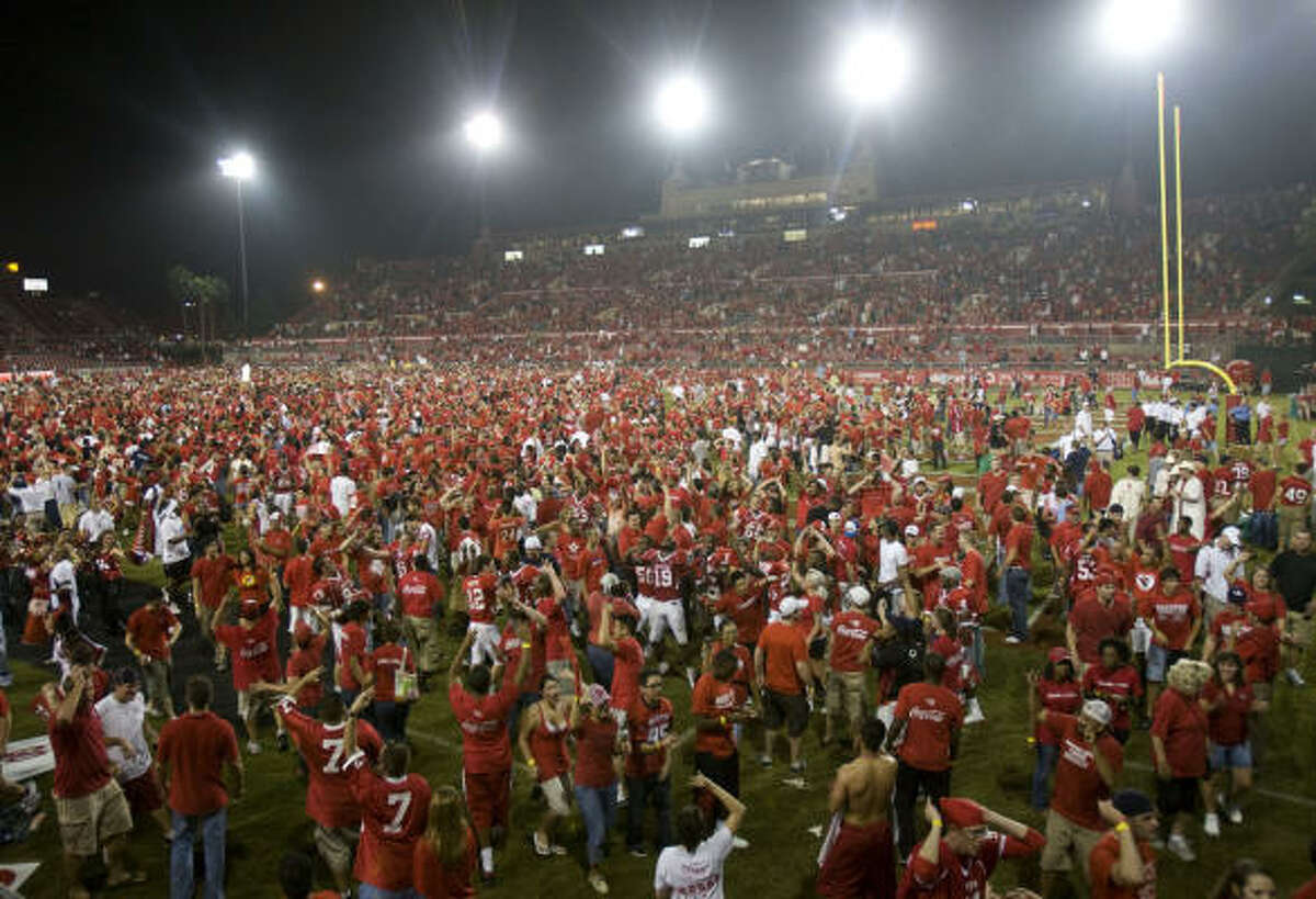 Houston fans storm the field following the Cougars' victory over Texas Tech on Saturday night at Robertston Stadium.