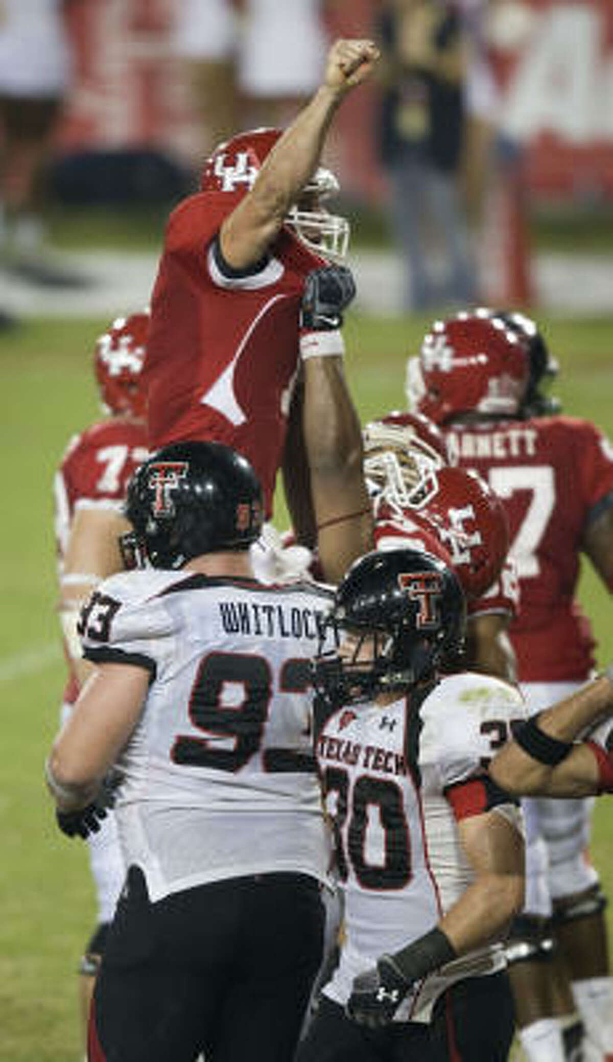 Houston quarterback Case Keenum (7) celebrates after he scored the game-winning touchdown.