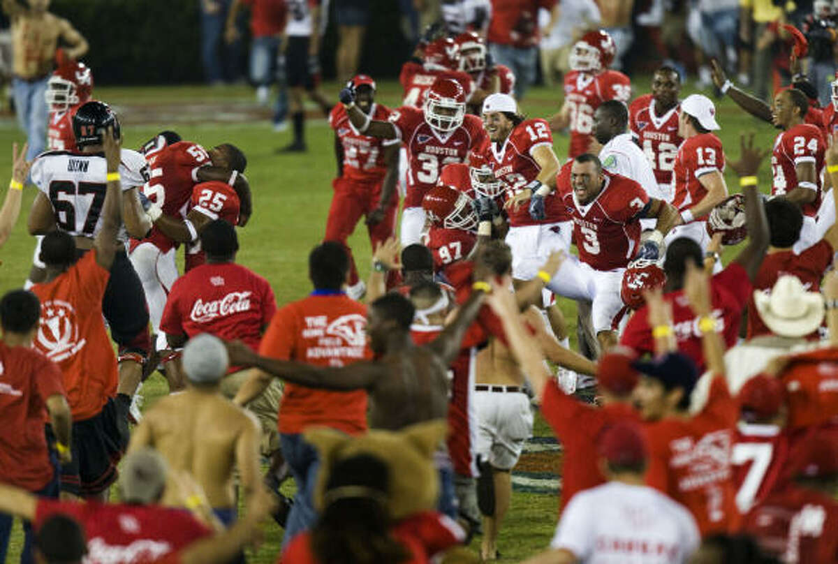 Houston player celebrate as their fans storm the field.