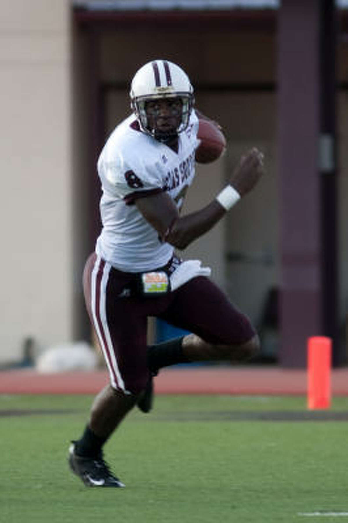The Texas State defense forces TSU quarterback Arvell Nelson to run in the first quarter.